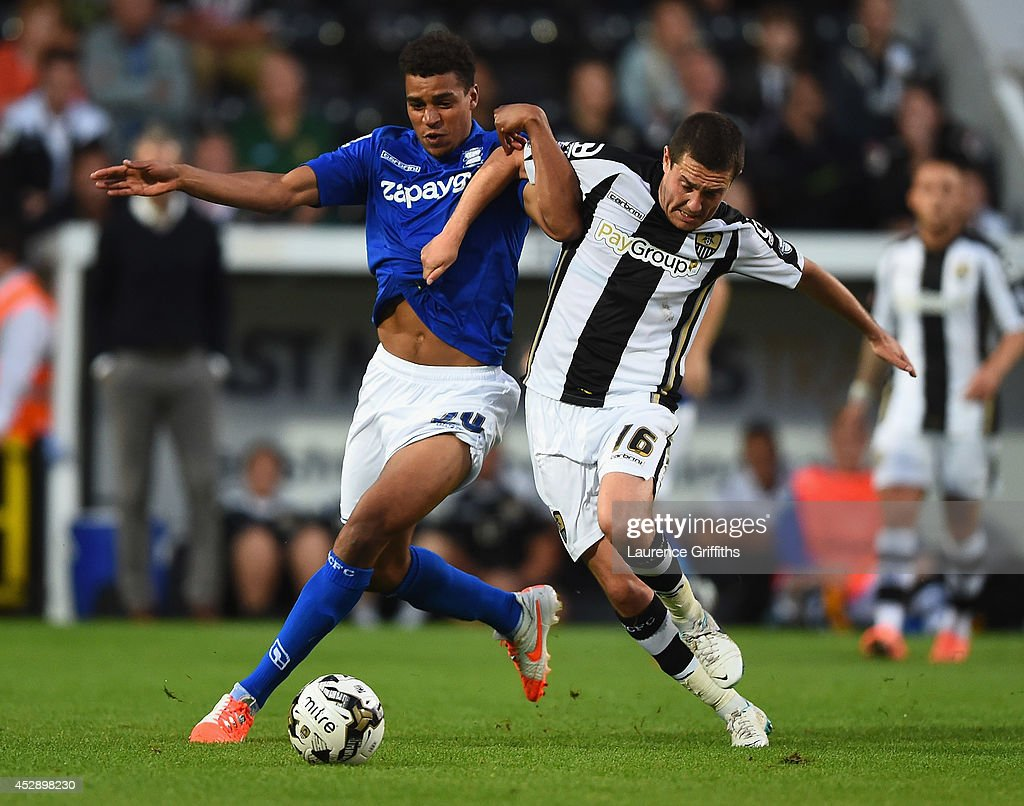 Tom Adeyemi of Birmingham City battles with Liam Noble of Notts County during the Pre Season Friendly match between Notts County and Birmingham City at Meadow Lane on July 29, 2014 in Nottingham, England.