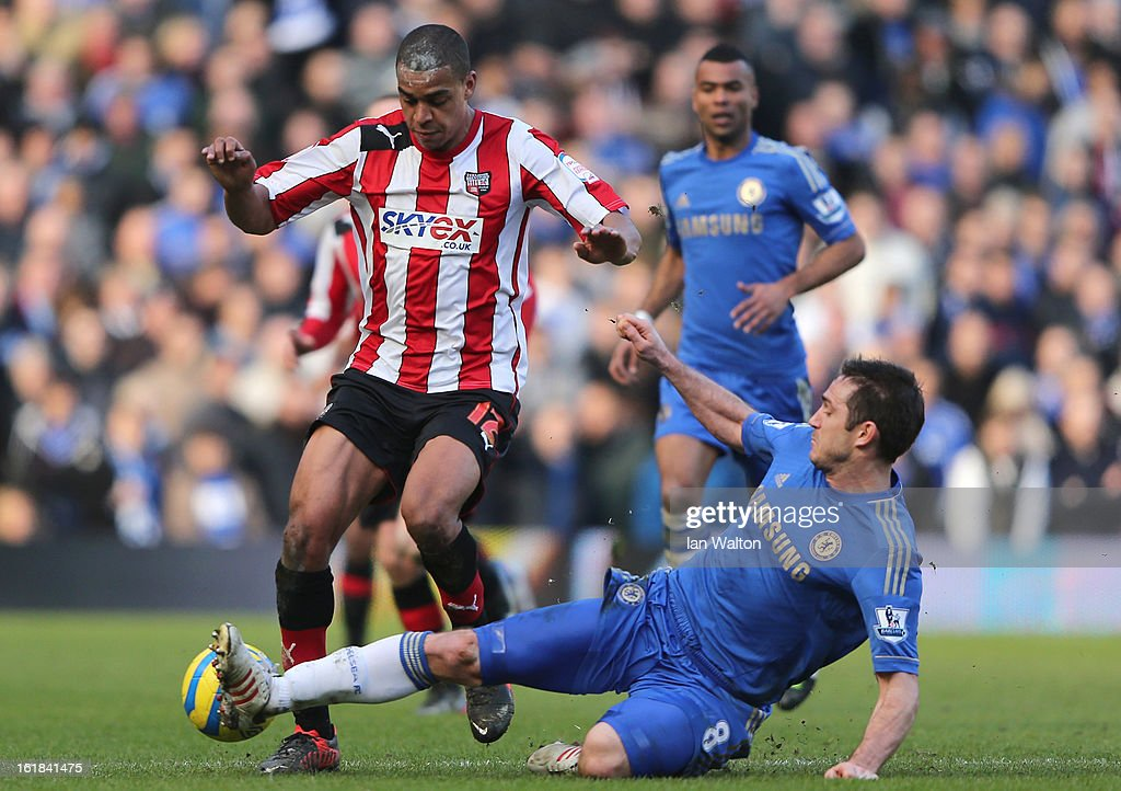 Tom Adeyemi of Brentford is tackled by <a gi-track='captionPersonalityLinkClicked' href=/galleries/search?phrase=Frank+Lampard+-+F%C3%B6dd+1978&family=editorial&specificpeople=11497645 ng-click='$event.stopPropagation()'>Frank Lampard</a> of Chelsea during the FA Cup Fourth Round Replay match between Chelsea and Brentford at Stamford Bridge on February 17, 2013 in London, England.