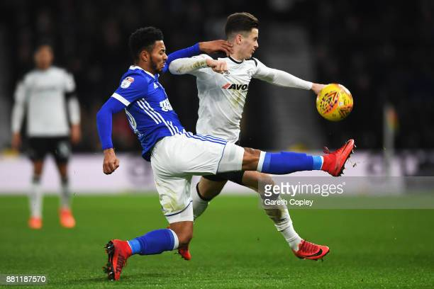 Tom Adeyemi of Ipswich Town battles for the ball with Tom Lawrence of Derby County during the Sky Bet Championship match between Derby County and...