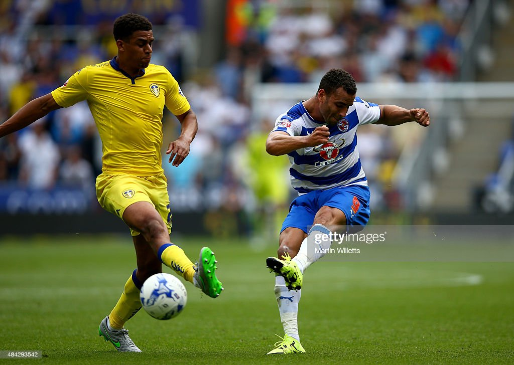 Tom Adeyemi of Leeds United and Hal Robson-Kanu of Reading during the Sky Bet Championship match between Reading and Leeds United at Madejski Stadium on August 16, 2015 in Reading, England.