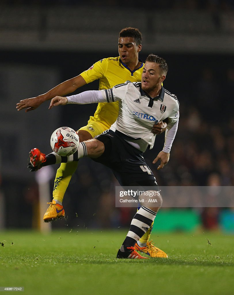 Tom Adeyemi of Leeds United and Ross McCormack of Fulham during the Sky Bet Championship match between Fulham and Leeds United at Craven Cottage on October 21, 2015 in London, England.