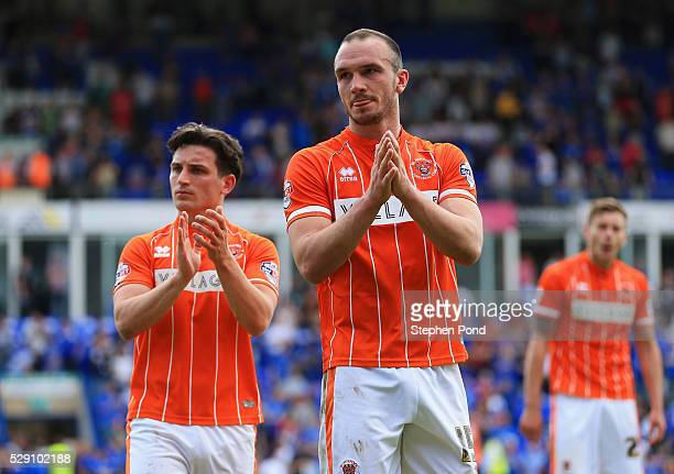 Tom Aldred and Jack Redshaw of Blackpool looks dejected as they are relegated after the Sky Bet League One match between Peterborough United and...