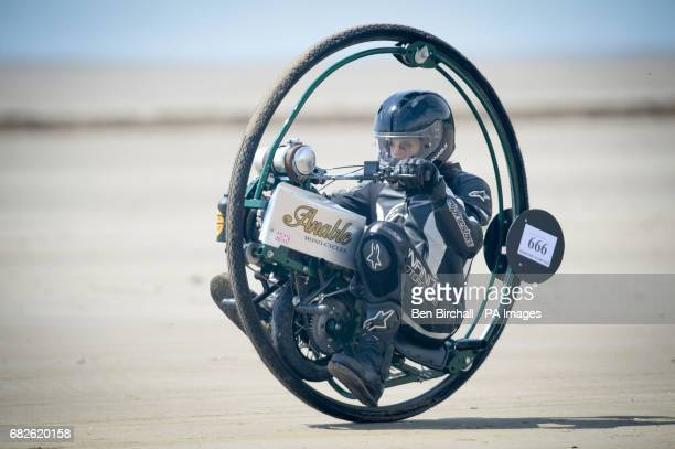Tom Anable from Lincolnshire rides his monowheel bike during the Straightliners 'Top Speed' event at Pendine Sands Wales where riders and drivers...