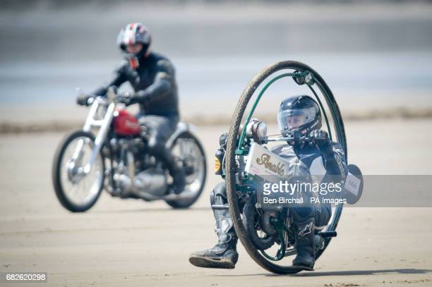 Tom Anable from Lincolnshire rides his monowheel bike in the Straightliners 'Top Speed' event at Pendine Sands Wales where riders and drivers compete...