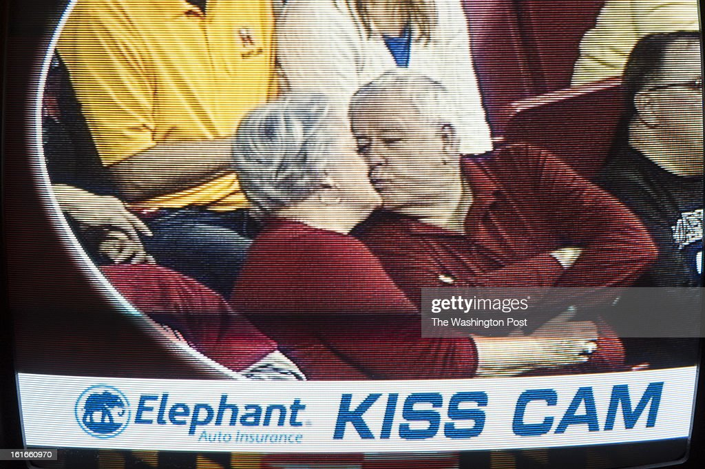 Tom, 68, and Betty, 64, Lugenbeel of Columbia, MD, kiss when caught on the kiss cam during the first half of the Terps game against Virginia Sunday, February 10, 2013 in College Park, MD.