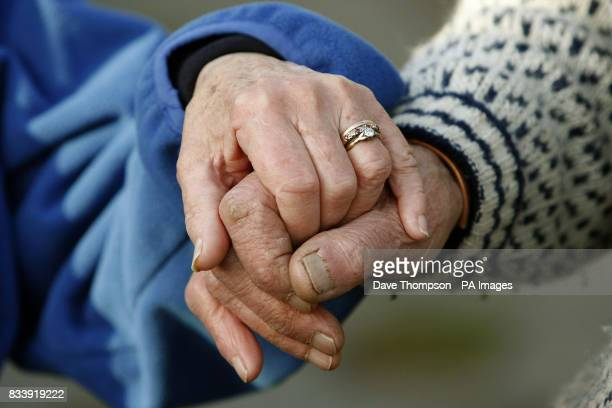 Tom and Joyce Robinson hold hands outside their home in Carperby North Yorkshire The couple celebrate their Diamond Wedding Anniversary on November...