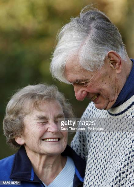 Tom and Joyce Robinson laugh as they pose for photographs outside their home in Carperby North Yorkshire The couple celebrate their Diamond Wedding...
