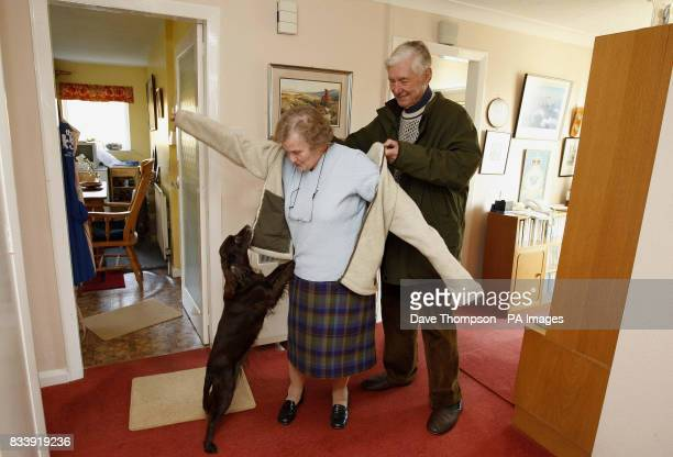 Tom and Joyce Robinson prepare to take their dog Calypso for a walk at their home in Carperby North Yorkshire The couple celebrate their Diamond...