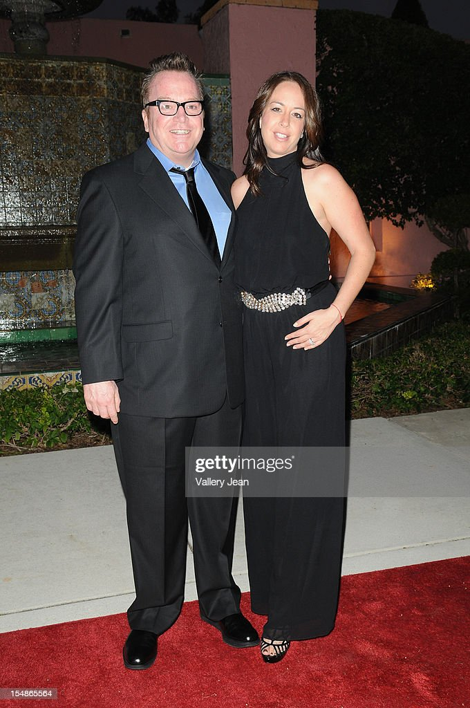 <a gi-track='captionPersonalityLinkClicked' href=/galleries/search?phrase=Tom+Arnold&family=editorial&specificpeople=202506 ng-click='$event.stopPropagation()'>Tom Arnold</a> and Martha Delafield arrive at 23rd Annual Chris Evert/Raymond James Pro-Celebrity Tennis Classic Gala at Boca Raton Resort on October 27, 2012 in Boca Raton, Florida.