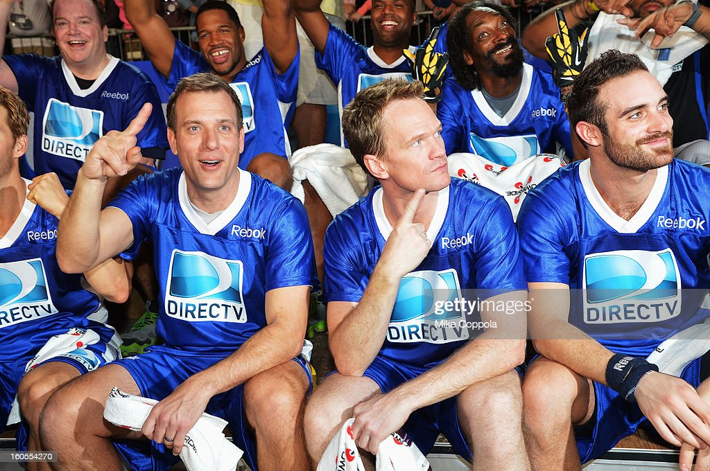 Tom Arnold, Michael Strahan, Kevin Frazier, Snoop Lion (front row L-R) Ryan Kwanten, Mike Bettes, Neil Patrick Harris, Joshua Sasse and Ian Somerhalder attend DIRECTV'S Seventh Annual Celebrity Beach Bowl at DTV SuperFan Stadium at Mardi Gras World on February 2, 2013 in New Orleans, Louisiana.
