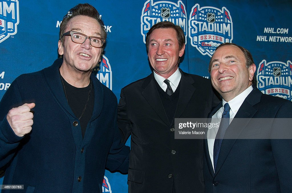 Tom Arnold, Wayne Gretzky and Gary Bettman arrive at the 2014 Coors Light NHL Stadium Series Los Angeles at Dodger Stadium on January 25, 2014 in Los Angeles, California.