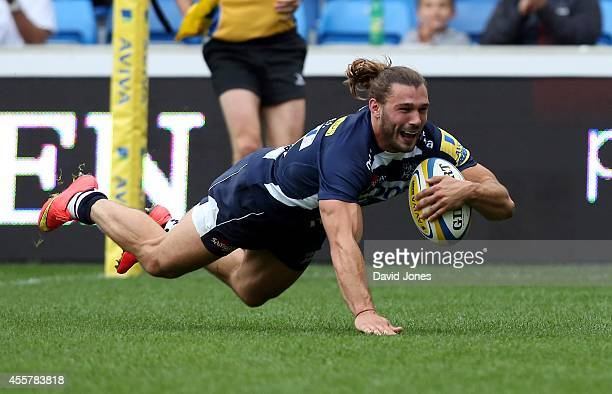Tom Arscott of Sale Sharks dives in for his hat trick try against London Welsh during the Aviva Premiership match between Sales Sharks and London...
