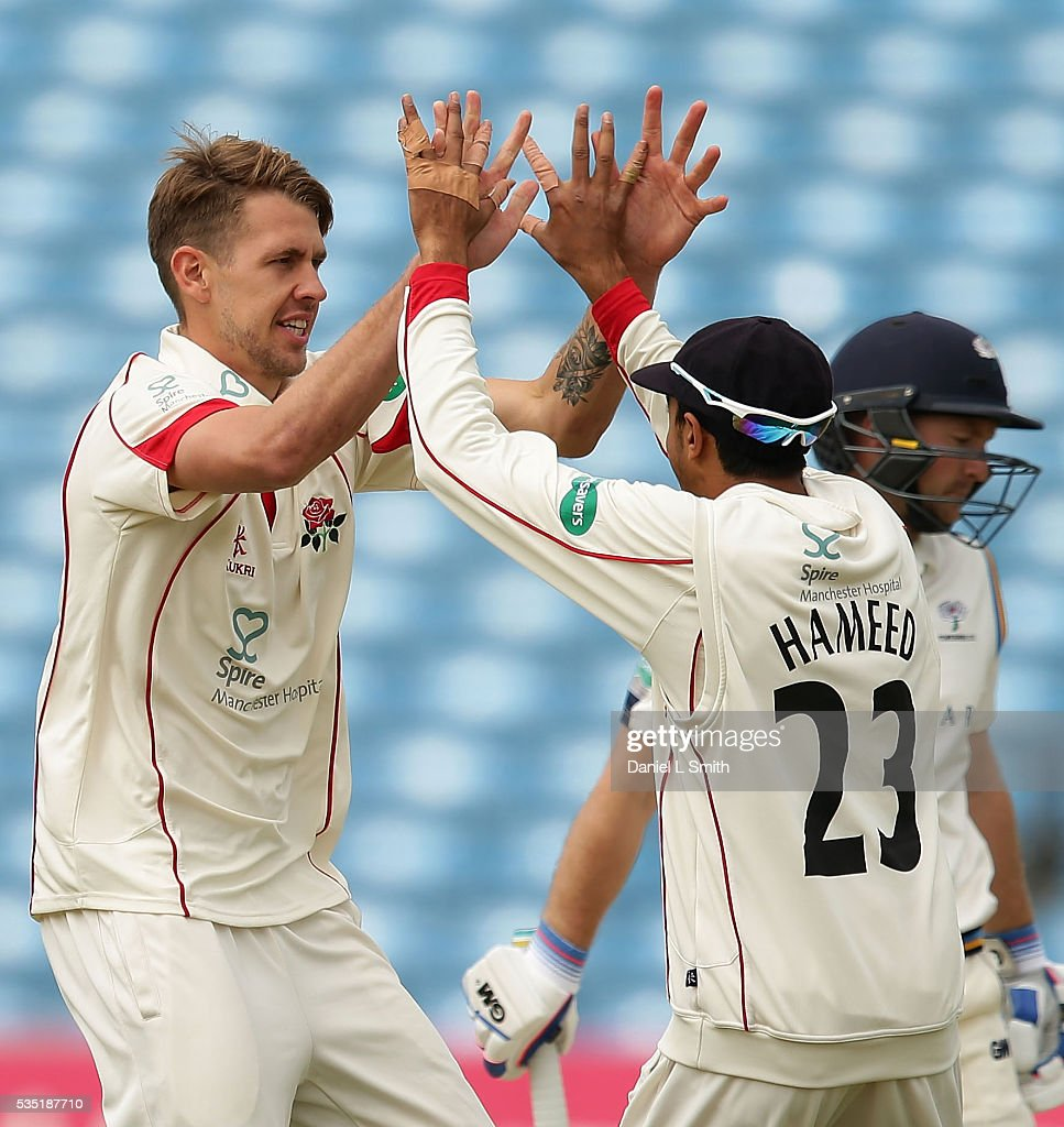 Tom Bailey (L) and Haseeb Hameedof Lancashire celebrate the dismissal of Adam Lyth of Yorkshire during day one of the Specsavers County Championship: Division One match between Yorkshire and Lancashire at Headingley on May 29, 2016 in Leeds, England.
