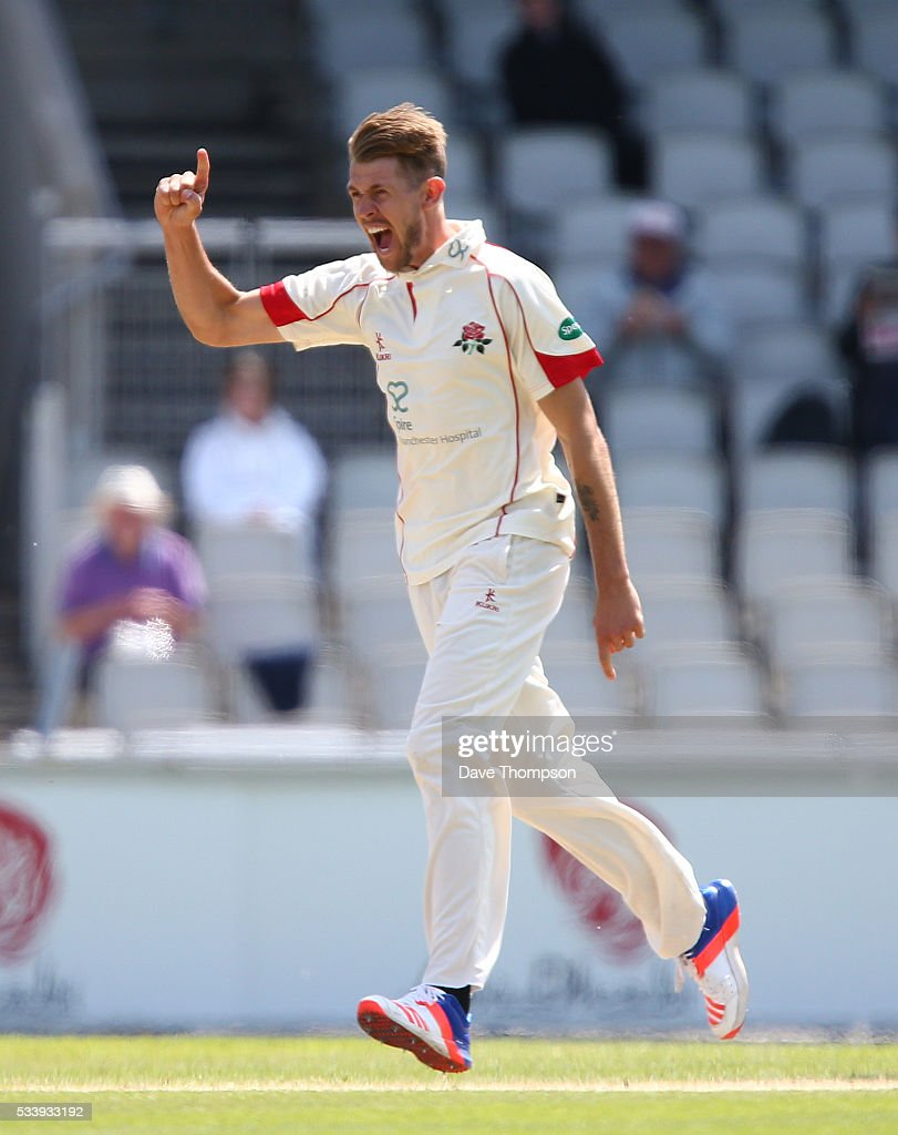 Tom Bailey of Lancashire celebrates taking the wicket of Arun Harinath of Surrey during the Specsavers County Championship Division One match between Lancashire and Surrey at The Emirates Old Trafford Cricket Ground on May 24, 2016 in Manchester, England.