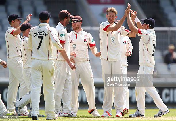 Tom Bailey of Lancashire celebrates taking the wicket of Arun Harinath of Surrey during the Specsavers County Championship Division One match between...