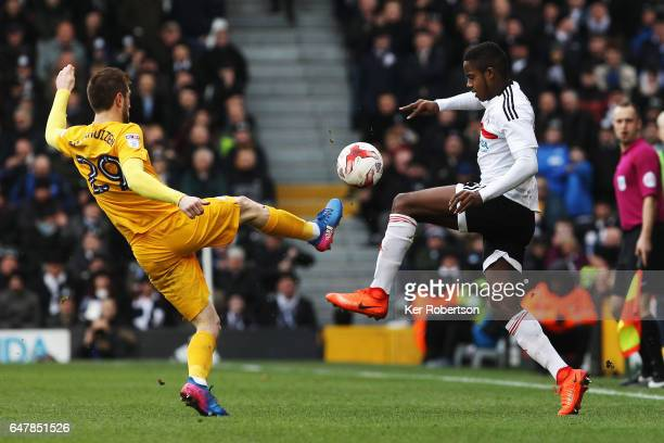 Tom Barkhuizen of Preston North End and Ryan Sessegnon of Fulham challenge for the ball during the Sky Bet Championship match between Fulham and...