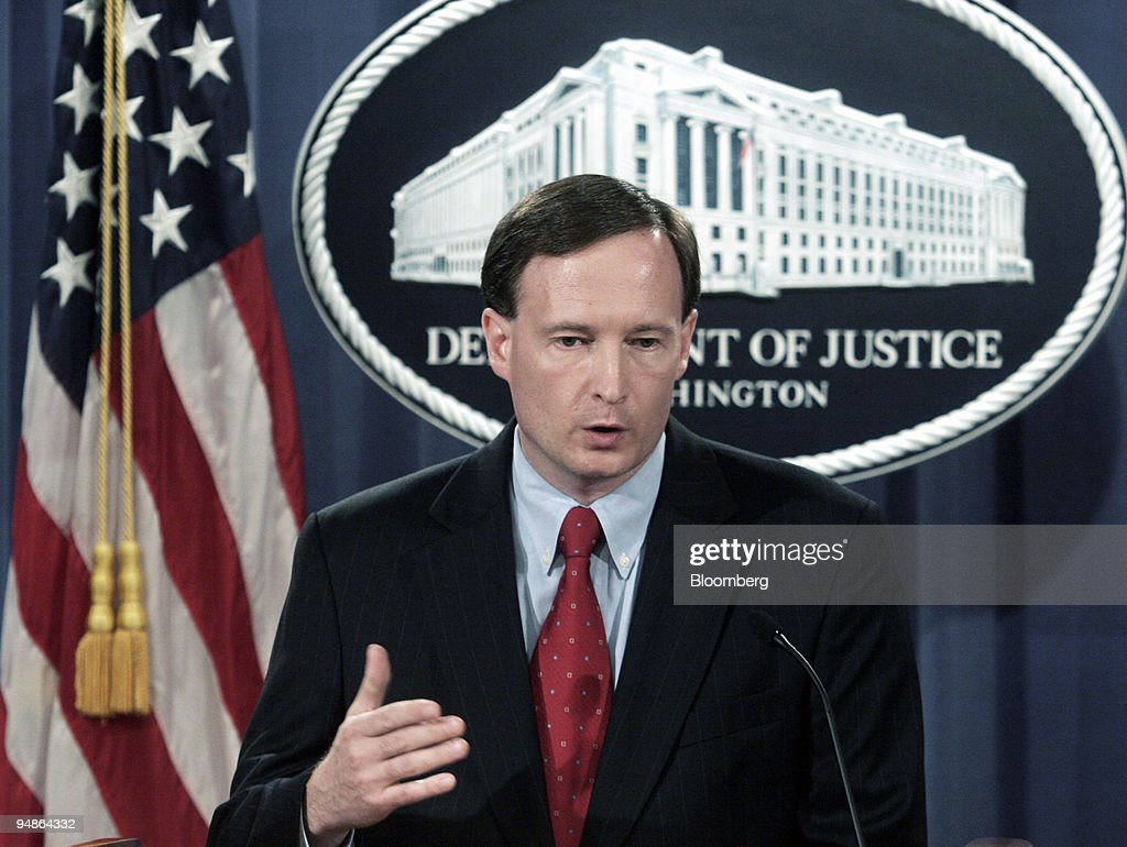 Tom Barnett acting chief of the Justice Department's antitrust division gestures during a news conference at the Department of Justice in Washington...