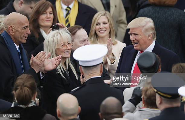 Tom Barrack Miriam Adelson and Sheldon Adelson greet US Presidentelect Donald Trump on the West Front of the US Capitol on January 20 2017 in...