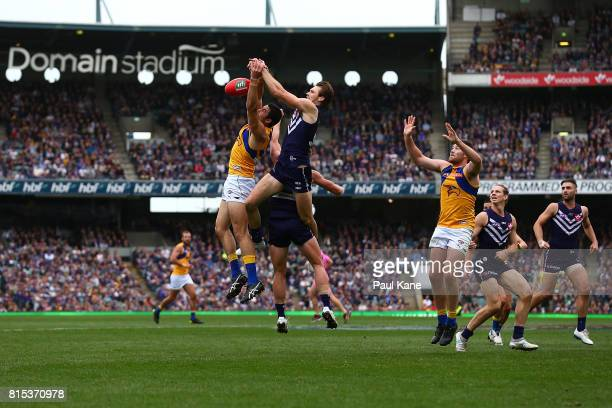 Tom Barrass of the Eagles and Joel Hamling of the Dockers contest a mark during the round 17 AFL match between the Fremantle Dockers and the West...