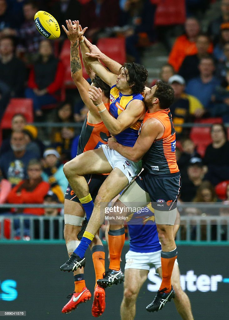 Tom Barrass of the Eagles and Shane Mumford of the Giants contest a mark during the round 21 AFL match between the Greater Western Sydney Giants and...