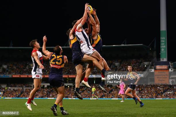 Tom Barrass of the Eagles marks the ball against Cameron Pedersen of the Demons during the round 14 AFL match between the West Coast Eagles and the...