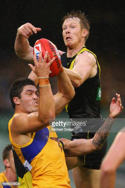 Tom Barrass of the Eagles marks the ball against Jack Riewoldt of the Tigers during the round three AFL match between the Richmond Tigers and the...