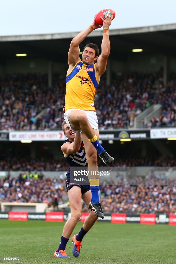 Tom Barrass of the Eagles marks the ball against Luke Ryan of the Dockers during the round 17 AFL match between the Fremantle Dockers and the West Coast Eagles at Domain Stadium on July 16, 2017 in Perth, Australia.