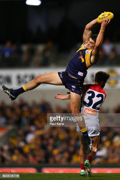 Tom Barrass of the Eagles marks the ball against Tomas Bugg of the Demons during the round 14 AFL match between the West Coast Eagles and the...