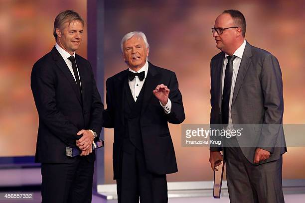 Tom Bartels Dieter Kuerten and Oliver Welke attend the Deutscher Fernsehpreis 2014 show on October 02 2014 in Cologne Germany
