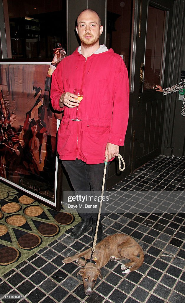 Tom Beard attends an exclusive preview of the 'Thomas Campbell Paints Lily and Lionel' collection of wearable art, in association with the English National Ballet, at CoutureLab on June 25, 2013 in London, England.