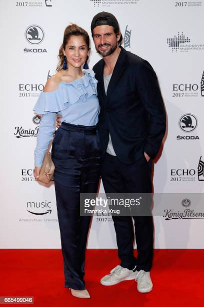 Tom Beck and his girlfriend Chryssanthi Kavazi attend the Echo award red carpet on April 6 2017 in Berlin Germany