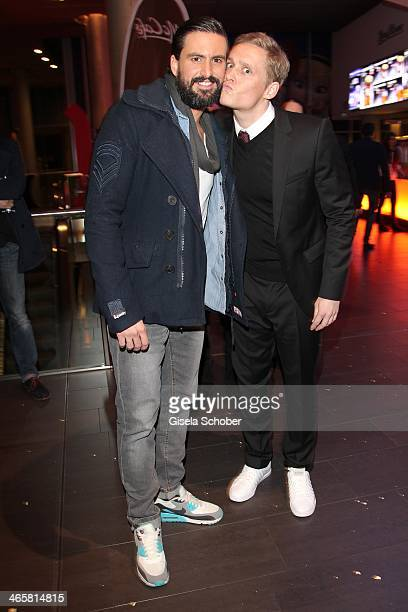 Tom Beck and Matthias Schweighoefer attend the premiere of the film 'Vaterfreuden' at Mathaeser Filmpalast on January 29 2014 in Munich Germany