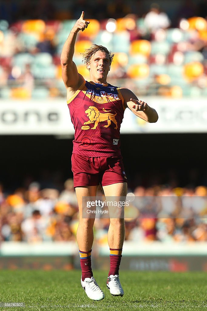 Tom Bell of the Lions celebrates a goal during the round 10 AFL match between the Brisbane Lions and the Hawthorn Hawks at The Gabba on May 28, 2016 in Brisbane, Australia.