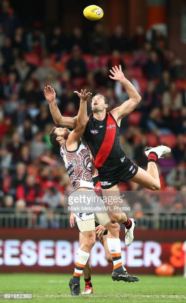Tom Bellchambers of the Bombers and Shane Mumford of the Giants compete during the round 11 AFL match between the Greater Western Sydney Giants and...