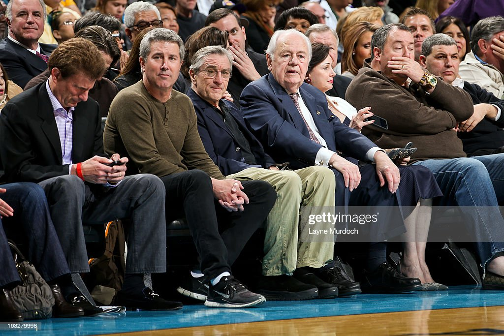 Tom Benson, owner of the New Orleans Hornets, center right, and actor <a gi-track='captionPersonalityLinkClicked' href=/galleries/search?phrase=Robert+De+Niro&family=editorial&specificpeople=201673 ng-click='$event.stopPropagation()'>Robert De Niro</a>, center left, attend a game between the Los Angeles Lakers and Hornets on March 6, 2013 at the New Orleans Arena in New Orleans, Louisiana.