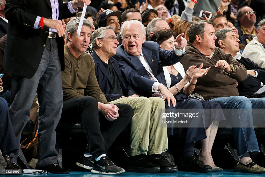 Tom Benson, owner of the New Orleans Hornets, center right, and actor <a gi-track='captionPersonalityLinkClicked' href=/galleries/search?phrase=Robert+De+Niro&family=editorial&specificpeople=201673 ng-click='$event.stopPropagation()'>Robert De Niro</a>, center left, speak during a game between the Los Angeles Lakers and Hornets on March 6, 2013 at the New Orleans Arena in New Orleans, Louisiana.
