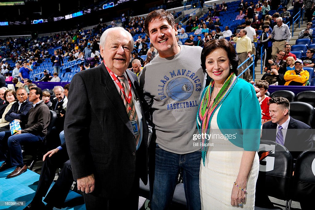 Tom Benson, owner of the New Orleans Hornets, left, and his wife Gayle, pose with Mark Cuban, owner of the Dallas Mavericks, before a game between the two teams on February 22, 2013 at the New Orleans Arena in New Orleans, Louisiana.