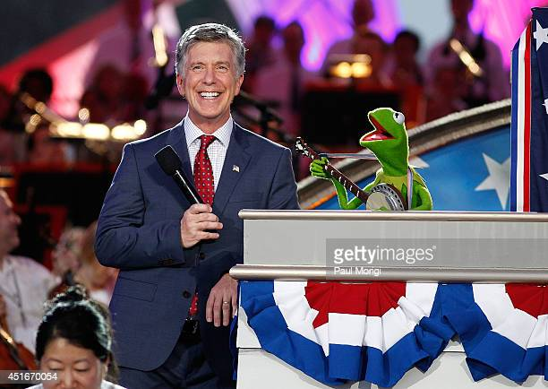 Tom Bergeron and Kermit the Frog onstage at PBS's 2014 A CAPITOL FOURTH rehearsals at US Capitol West Lawn on July 3 2014 in Washington DC