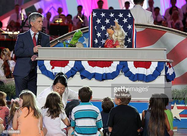 Tom Bergeron Kermit the Frog and Miss Piggy onstage at PBS's 2014 A CAPITOL FOURTH rehearsals at US Capitol West Lawn on July 3 2014 in Washington DC