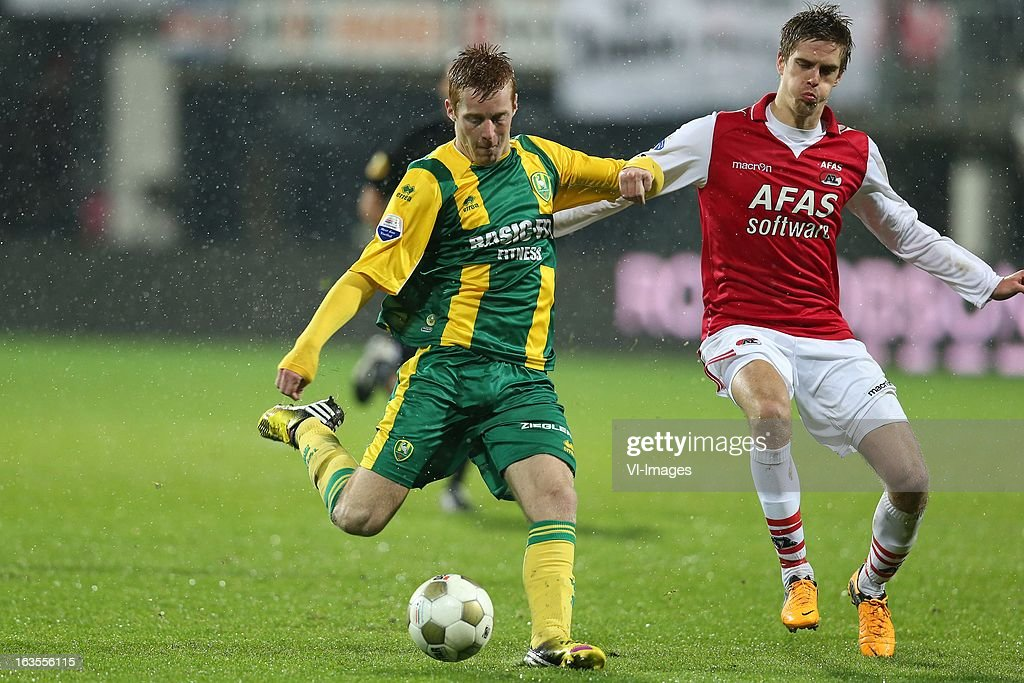 Tom Beugelsdijk of ADO Den Haag ,Markus Henriksen osf AZ during the Dutch Eredivisie match between AZ Alkmaar and ADO Den Haag at the AFAS Stadium on march 09, 2013 in Alkmaar, The Netherlands