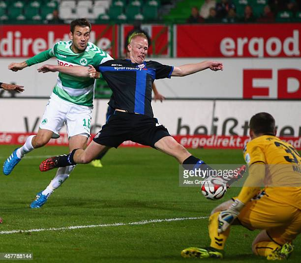 Tom Beugelsdijk of Frankfurt scores his team's second goal against goalkeeper Tom Mickel and Goran Sukalo of Greuther Fuerth during the Second...