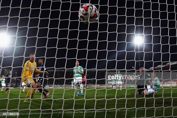 Tom Beugelsdijk of Frankfurt scores his team's second goal against goalkeeper Tom Mickel of Greuther Fuerth during the Second Bundesliga match...