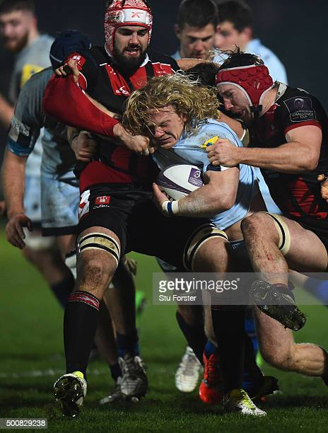 Tom Biggs of Worcester is gang tackled by the Gloucester defence during the European Rugby Challenge Cup match between Worcester Warriors and...