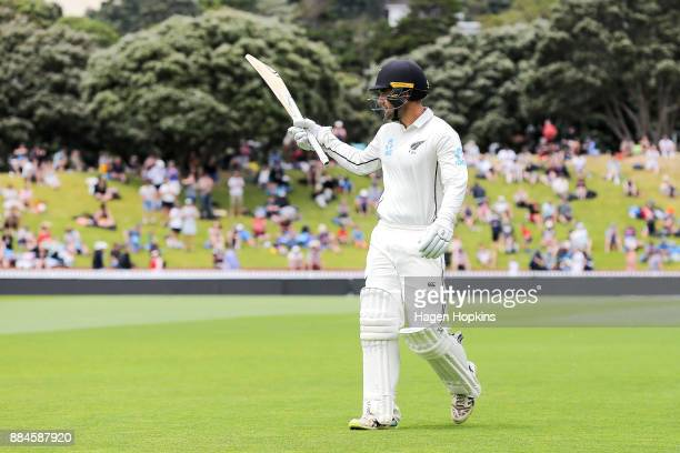 Tom Blundell of New Zealand acknowledges the crowd at the end of the innings after reaching his maiden test century on debut during day three of the...