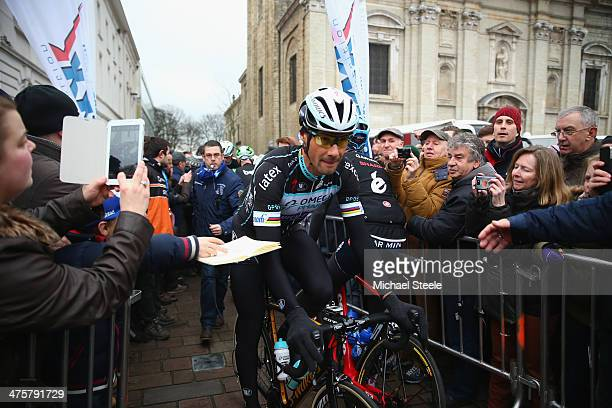 Tom Boonen of Belgium and Omega PharmaQuick Step Cycling Team heads through the crowds ato sign on during the Omloop Het Nieuwsblad on March 1 2014...