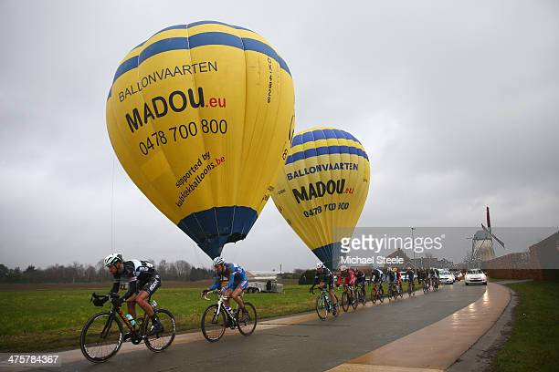 Tom Boonen of Belgium and Omega PharmaQuick Step Cycling Team leads past balloons and a windmill during the Omloop Het Nieuwsblad on March 1 2014 in...