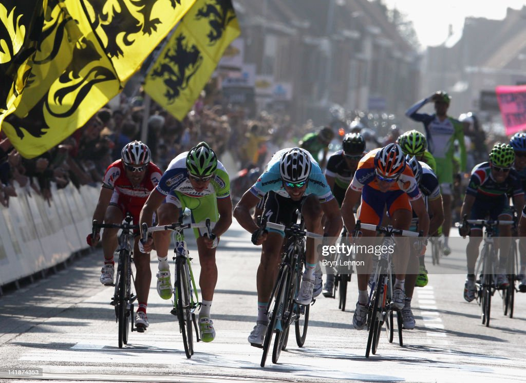 <a gi-track='captionPersonalityLinkClicked' href=/galleries/search?phrase=Tom+Boonen&family=editorial&specificpeople=221255 ng-click='$event.stopPropagation()'>Tom Boonen</a> of Belgium and Omega Pharma-Quick Step (centre) sprints for the finishline on his way to winning the 74th edition of the Gent - Wevelgem one day cycle race on March 25, 2012 in Wevelgem, Belgium.