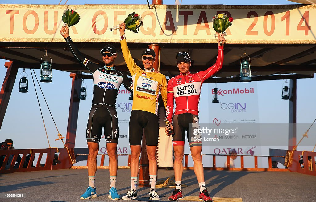 <a gi-track='captionPersonalityLinkClicked' href=/galleries/search?phrase=Tom+Boonen&family=editorial&specificpeople=221255 ng-click='$event.stopPropagation()'>Tom Boonen</a> of Belgium and Omega Pharm-QuickStep, <a gi-track='captionPersonalityLinkClicked' href=/galleries/search?phrase=Niki+Terpstra&family=editorial&specificpeople=609813 ng-click='$event.stopPropagation()'>Niki Terpstra</a> of The Netherlands and Omega Pharma-QuickStep and <a gi-track='captionPersonalityLinkClicked' href=/galleries/search?phrase=Jurgen+Roelandts&family=editorial&specificpeople=5014559 ng-click='$event.stopPropagation()'>Jurgen Roelandts</a> of Germany stand on the podium after stage six of the Tour of Qatar from Sealine Beach Resort to Doha Corniche on February 14, 2014 in Doha, Qatar.