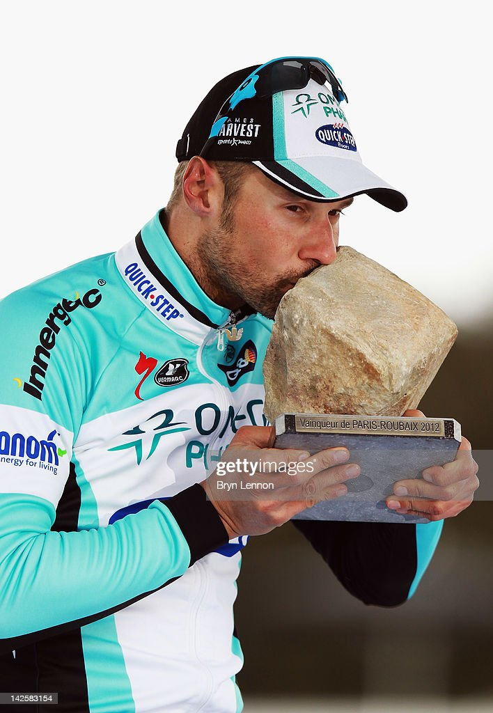 <a gi-track='captionPersonalityLinkClicked' href=/galleries/search?phrase=Tom+Boonen&family=editorial&specificpeople=221255 ng-click='$event.stopPropagation()'>Tom Boonen</a> of Belgium and Quick Step Omega Pharma celebrates winning the 2012 Paris Roubaix cycle race from Compiegne to Roubaix on April 8, 2012 in Paris, France. The 110th edition of the race is 257km long with 51.5km of cobbles spread over 27 sections.