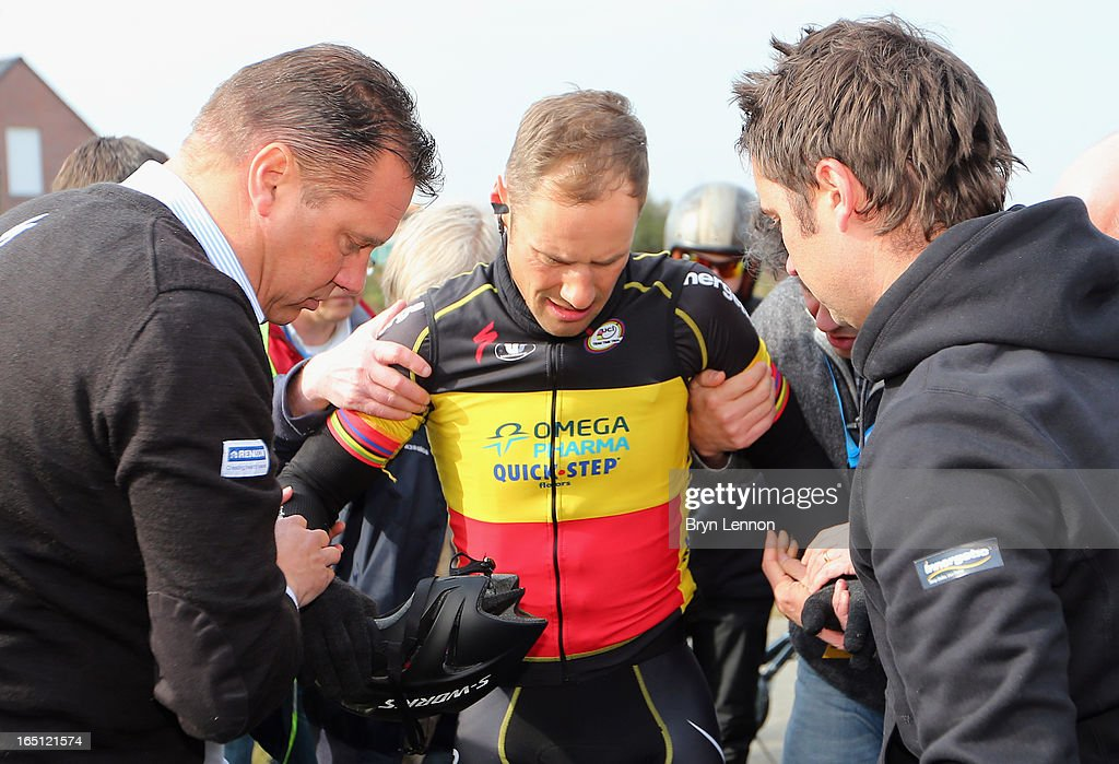 Tom Boonen of Omega Pharma-Quick Step and Belgium is helped to his feet after crashing during the 97th edition of the Tour of Flanders (Ronde van Vlaanderen) on March 31, 2013 in Brugge, Belgium. Boonen abandoned the race.